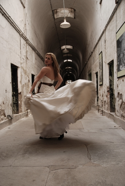 Bridal photos at the Eastern State Prison. Trash the dress wedding photographs.  Taken months after the wedding.
